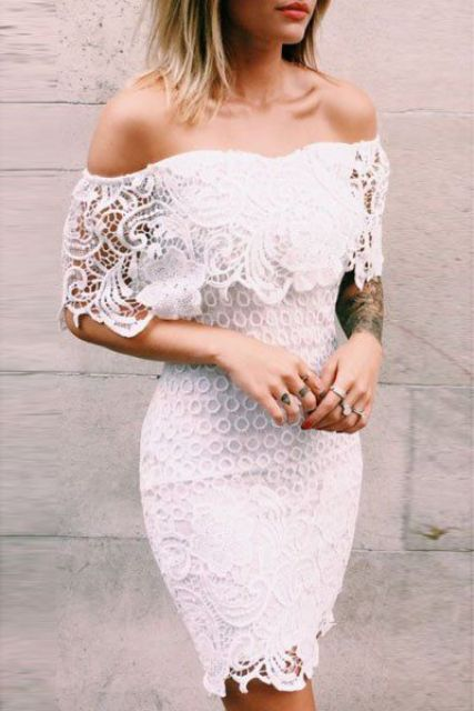 a white off the shoulder crochet mini dress