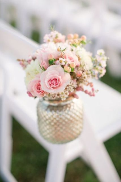 gilded mason jar with a delicate pink flower arrangement