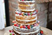 22 naked wedding cake with fresh berries and wood slice toppers