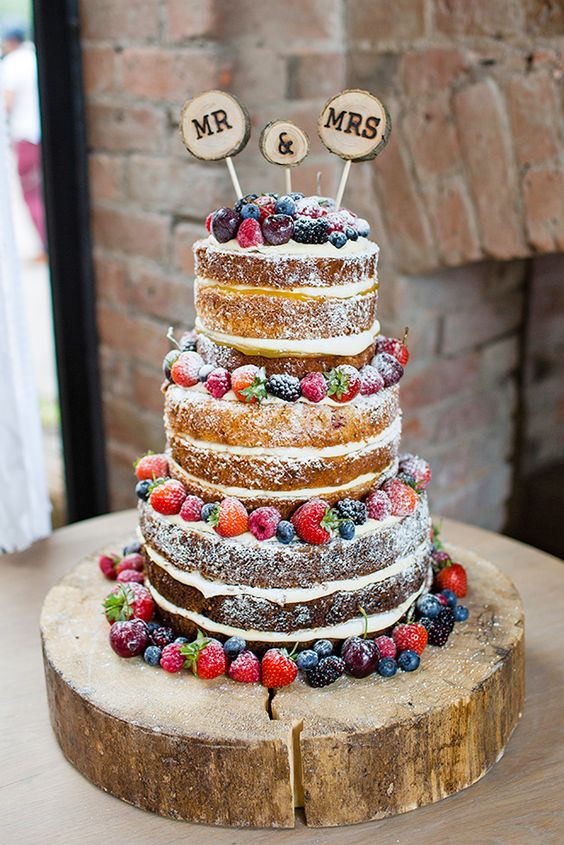 Picture Of Naked Wedding Cake With Fresh Berries And Wood Slice Toppers