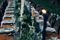 22 textural greenery table garland with blue glasses and candles