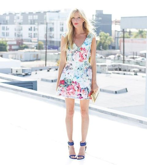 a floral mini dress with a V cut and navy ankle strap heels
