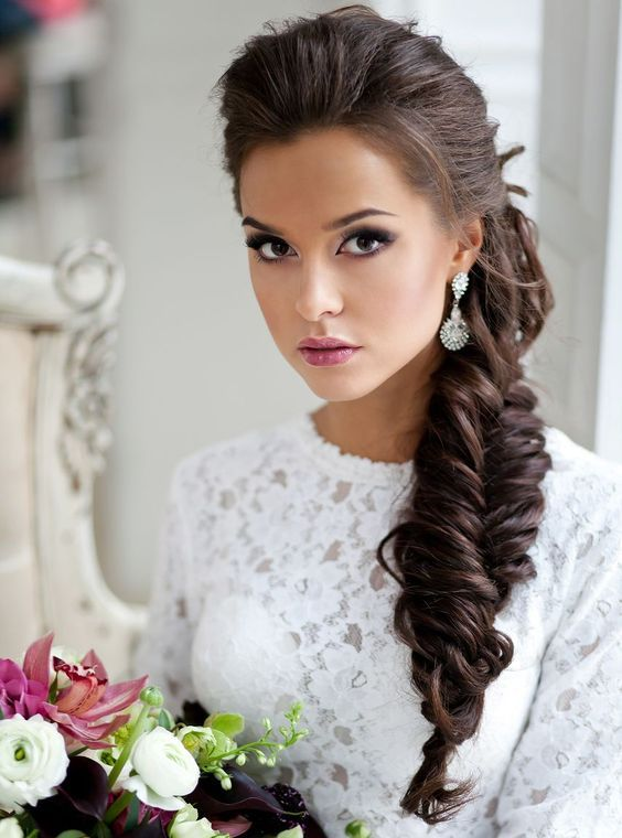 an oversized chunky fishtail braid looks gorgeous