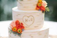 23 birch bark-inspired wedding cake with orange flowers