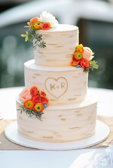 birch bark-inspired wedding cake with orange flowers