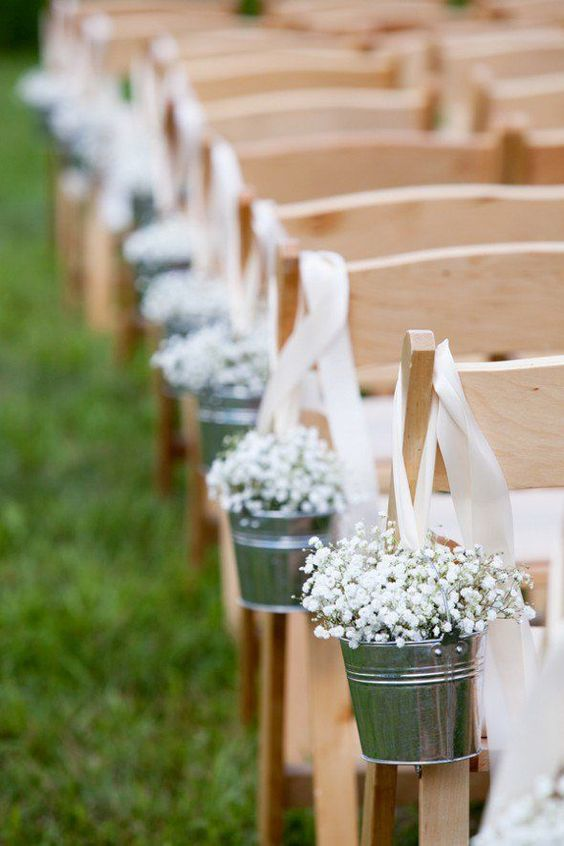 buckets on ribbon with baby's breath for a rustic wedding aisle