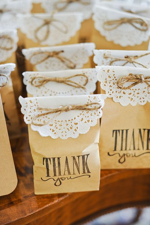 coffee bean bags covered with doilies and twine