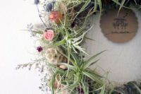 24 a cool textural wreath with air plants, wildflowers and tea roses