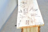 24 a wooden bench instead of a usual guest book