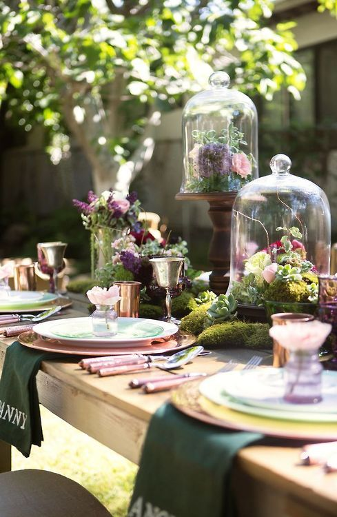 Cloches With Moss And Fresh Flowers On A Table Runner