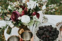 24 dark red roses make the serving moody