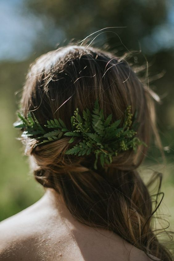 half up half down relaxed hairstyle with fresh leaves instead of blooms