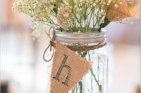 24 mason jar with a burlap table marking and baby's breath plus burlap flowers