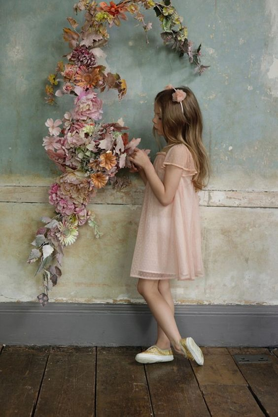 flower girl in gold shoes
