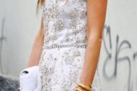 25 heavily jeweled white lace mini dress and a white clutch
