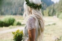 25 loose waves and a fresh greenery floral crown is a great choice for summer