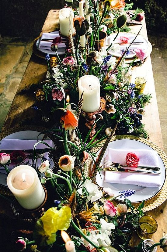 whimsy floral decor with candles and lavender napkins for a secret garden wedding