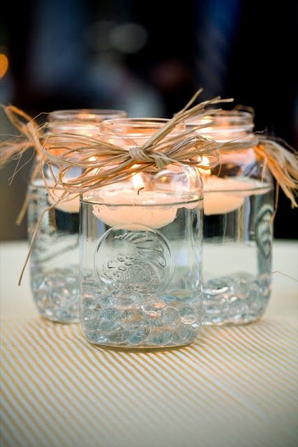 mason jars with twine and floating candles for decorating your rustic affair