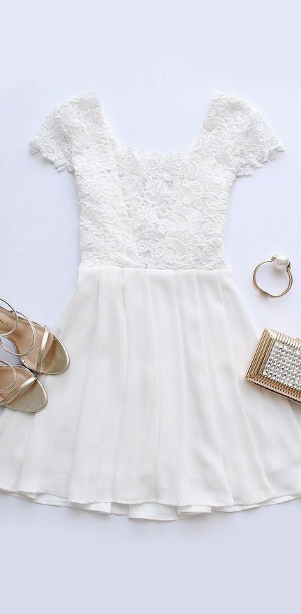 white dress with a lace bodice and short sleeves, metallic accessories