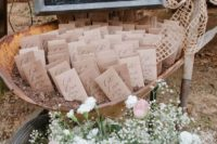 27 seeds as rustic wedding favors served in a garden trolley