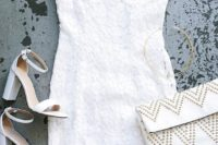 27 white flower dress with spaghetti straps, white heels and a nailed clutch