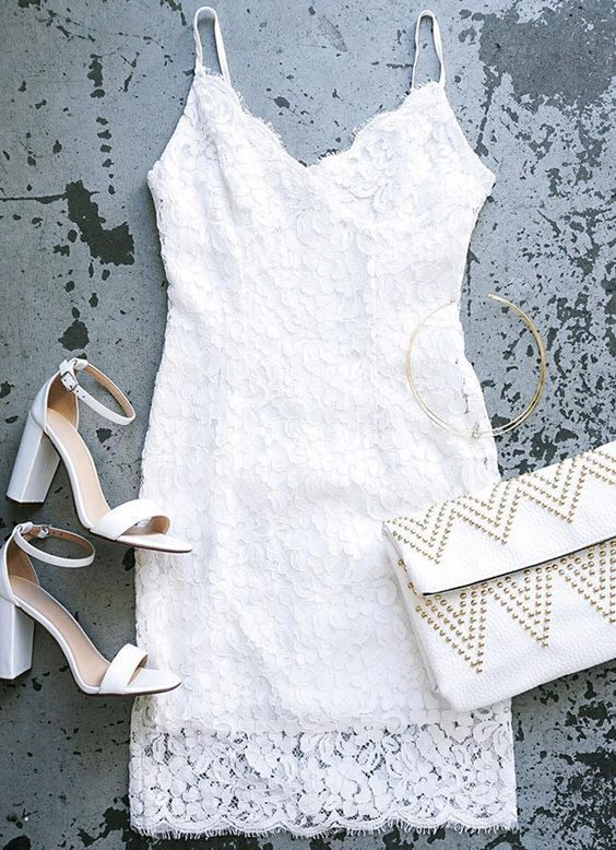white flower dress with spaghetti straps, white heels and a nailed clutch
