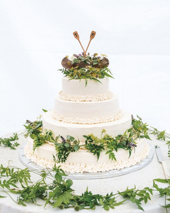 a hand-carved canoe and oars to top a wedding cake