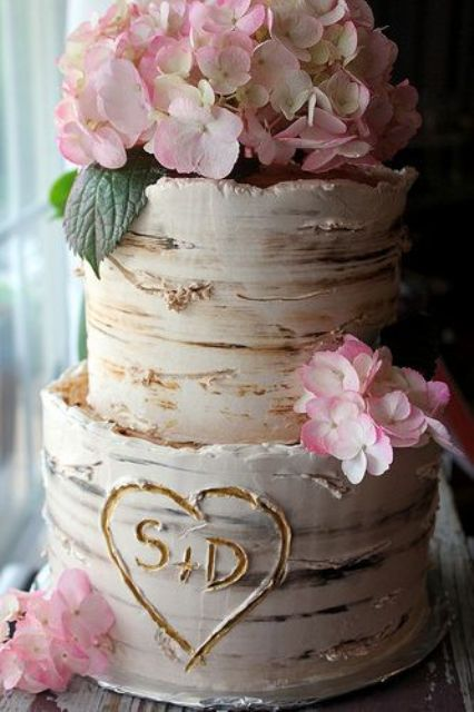 birch-inspired cake topped with pink hydrangeas