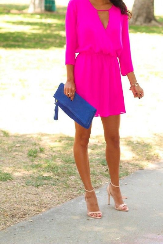 hot pink mini dress with sleeves, nude heels and a blue clutch