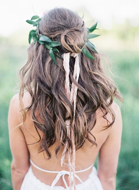 loose waves with a braid and a leaf crown look boho