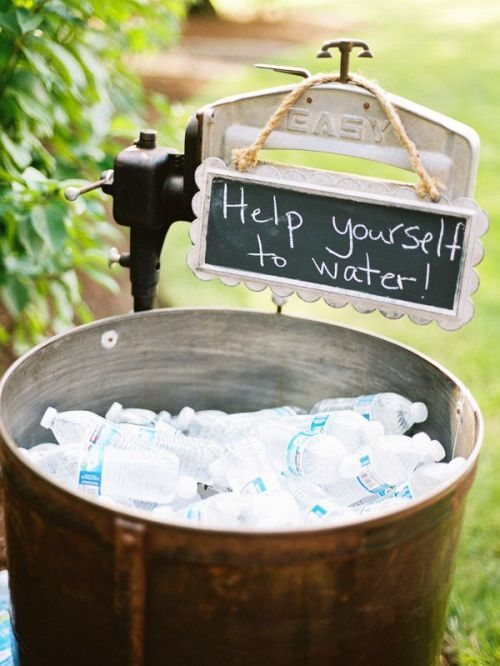 serve drinks in barrels filled with ice and hang signs to point at them