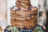 29 chocolate wedding cake topped with blackberry, blueberry and grapes