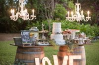 29 wine barrels and a simple wooden tray for a cake display. and chandeliers to add glam