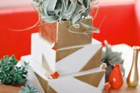 30 a metallic gold geometric wedding cake with a large air plant on top