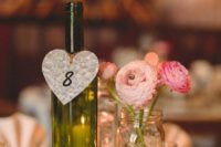 30 a vineyard centerpiece with a wine bottle, a mason jar as a vase and candles