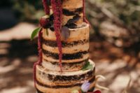 30 dark naked cake with red and purple flowers for a solstice wedding
