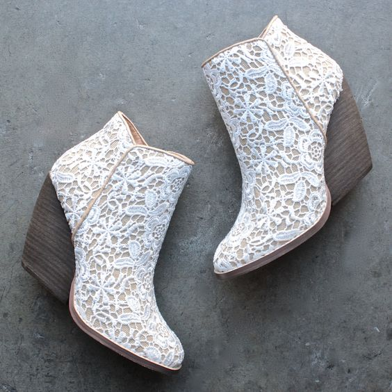 lace booties in cowvoy style and with large heels