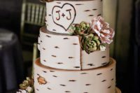 30 multi-tiered wedding cake topped with blooms and succulents