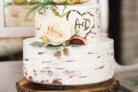31 a birch bak cake topped with antlers. blush roses and figs