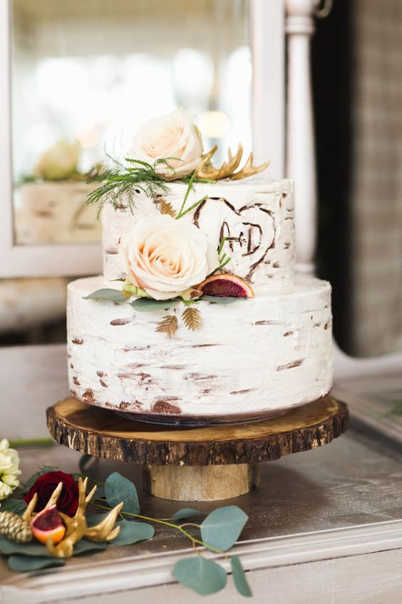 a birch bak cake topped with antlers. blush roses and figs