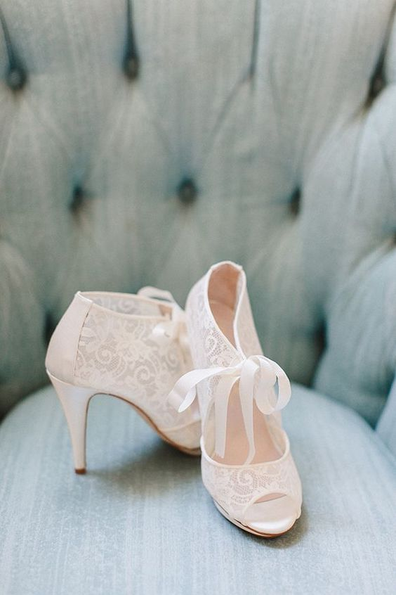 lace cutout booties with ribbon bows for a vintage bride