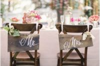 31 wooden signs and floral posies for chair decor