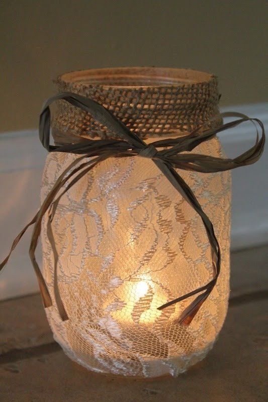 a lace candle lantern with burlap and twine