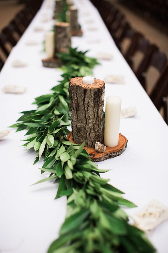 a wood slice with a wooden log and candles