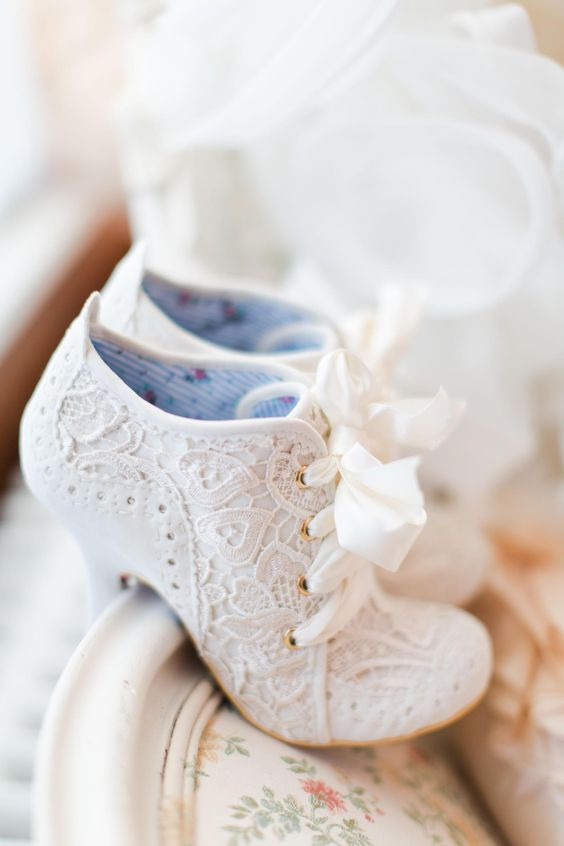 vintage-inspired lace booties with lacing up and heels