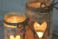 37 mason jars wrapped with note paper and with heart cutouts