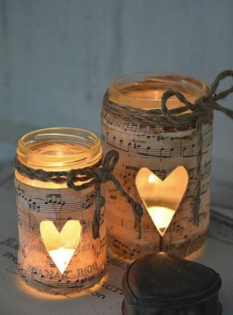 mason jars wrapped with note paper and with heart cutouts