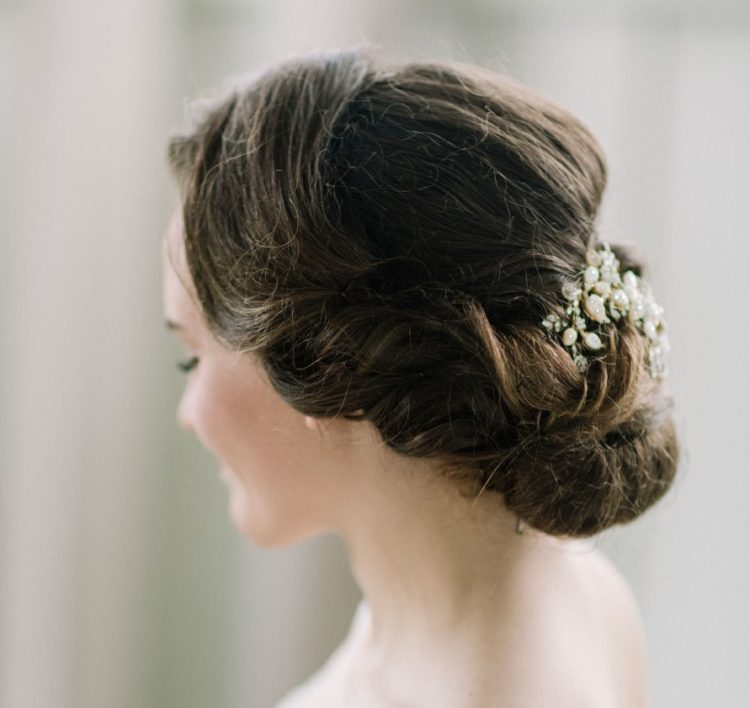A simple and elegant bridal twisted updo with a bead and pearl headpiece