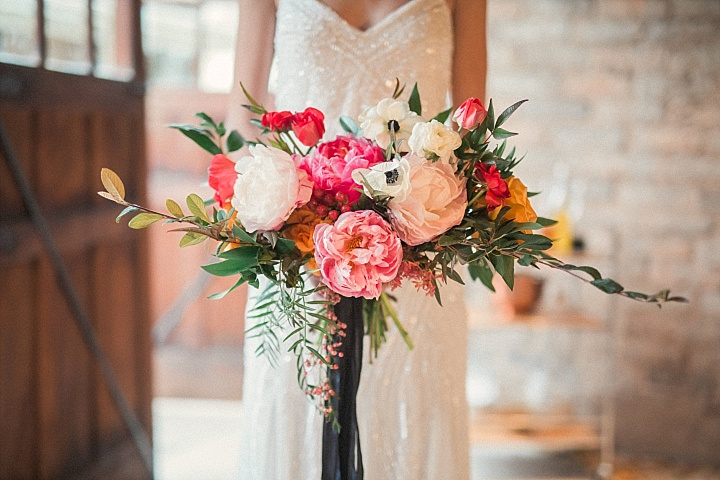 Bold bridal bouquet with lush peonies and textural greenery