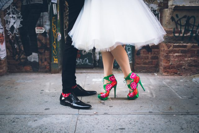 The bride was rocking gorgeous bold green, fuchsia and red stiletto heel booties